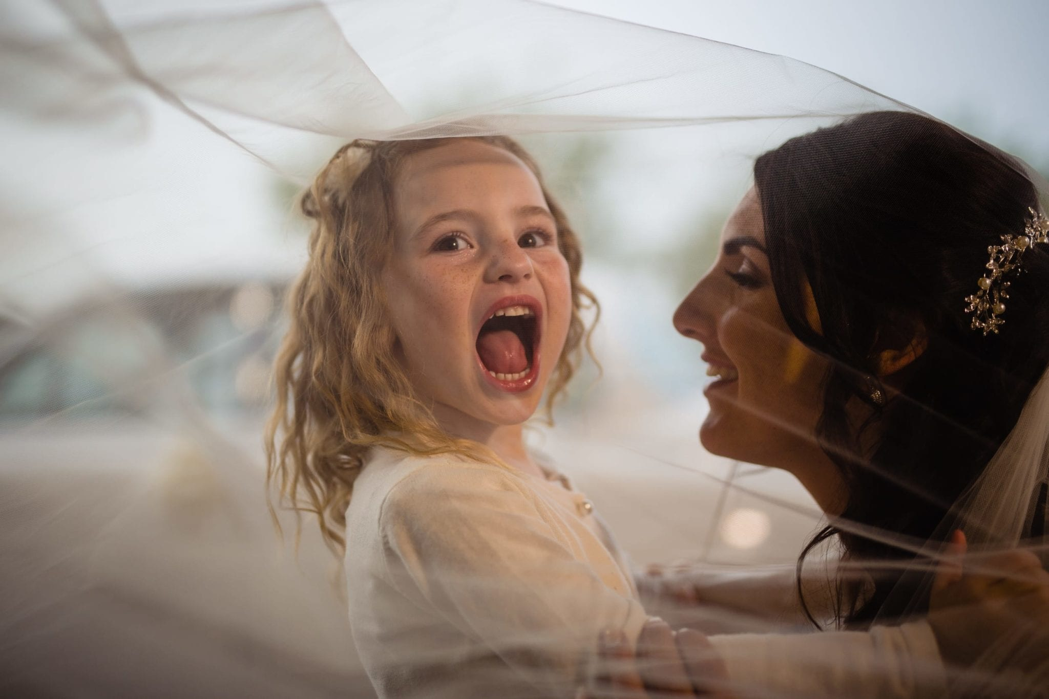 bride and daughter under veil