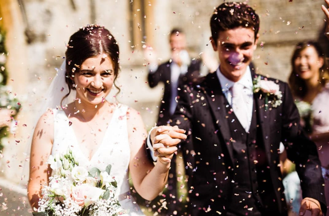 Wedding Photographer Essex - Confetti Happy Bride And Groom